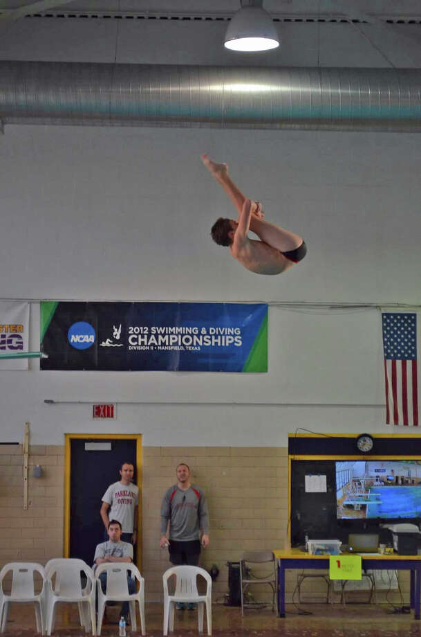 Darien's Owen Stevens holds a pike in mid air at the John Smith AAU Red White Blue National Qualifying meet in Rockville, Maryland on March 30, 2015. Stevens medaled in all four events. Photo: Contirbuted, Contributed / Darien News