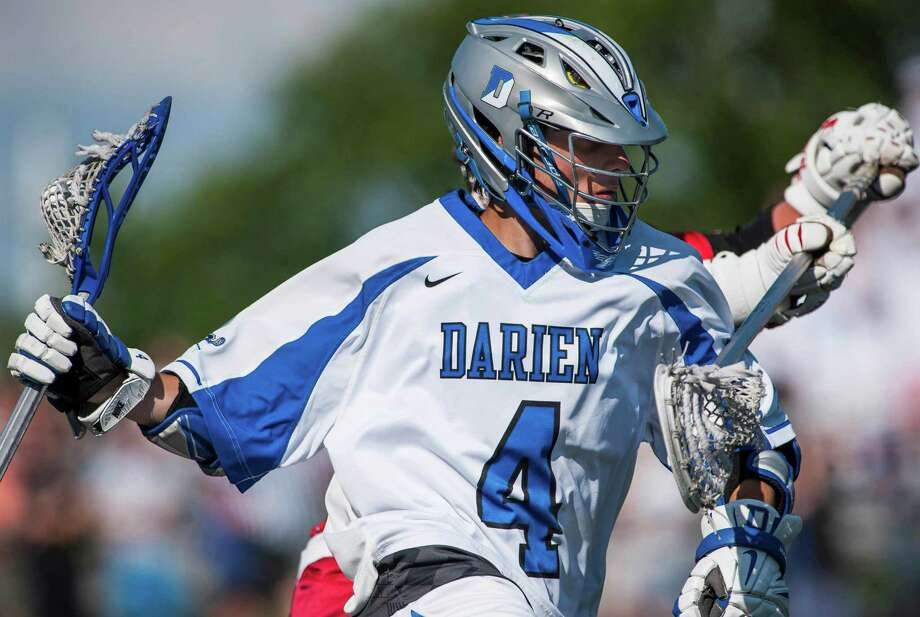 Darien high school's Jack Kniffin drives toward the goal during the CIAC class M boys lacrosse championship game against New Canaan high school played at Brien McMahon high school, Norwalk, CT on Saturday, June 14th, 2014. Photo: Mark Conrad / Connecticut Post Freelance