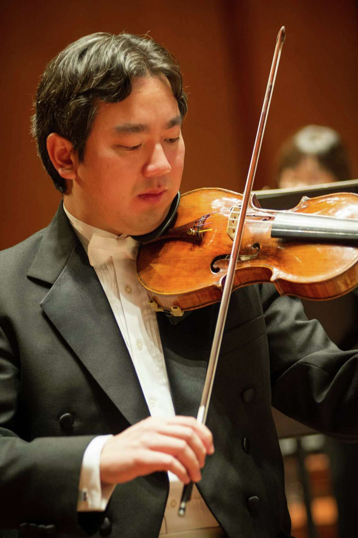 Violinist Frank Huang will lead the Houston Symphony in a concert at Discovery Green.