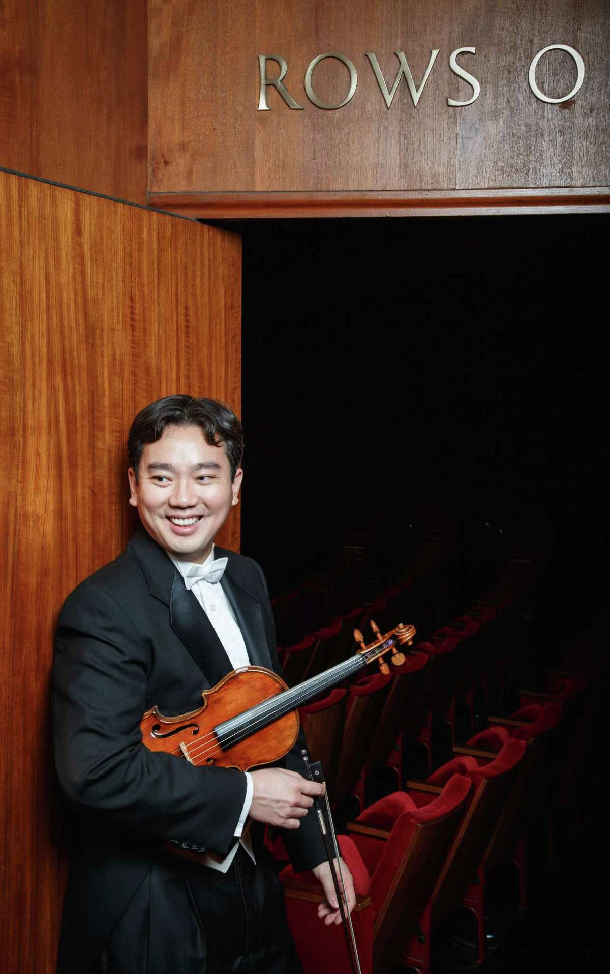 Houston Symphony musician Frank Huang (violin) poses for a photo, Wednesday, Dec. 5, 2012, in Houston. ( Michael Paulsen / Houston Chronicle )