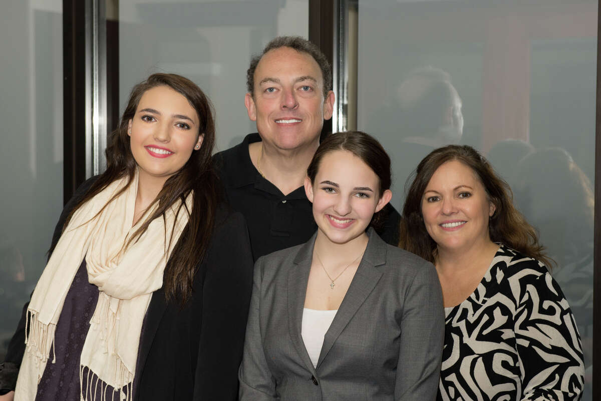 Houston lawyer, author and screenwriter David Healey, pictured with his family, wrote