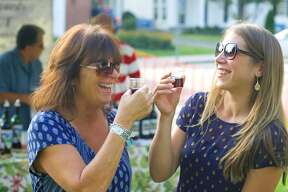 DiGrazia Vineyard - Brookfield Pictured: Deb Cipriani, left, of New Milford and former resident Jenn Marden enjoy a taste of Fieldstone Reserve, a dry red table wine, from DiGrazia Vineyard during A Taste of New Milford, Sept. 10, 2014 on the Village Green.