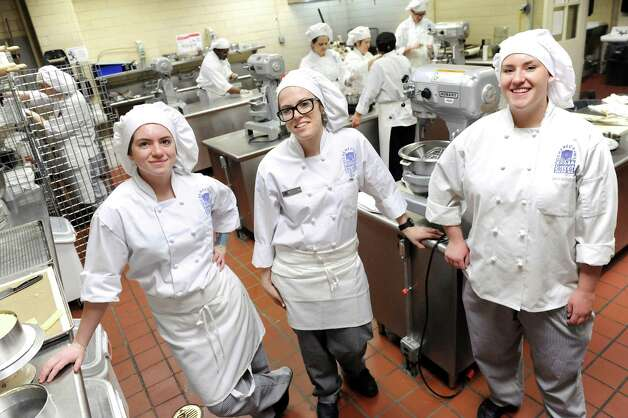Culinary students Abby Muir, 23, left, Erica Brucculeri, 26, center, and Gracie VanderVeen 23, in the baking lab on Tuesday, March 31, 2015, at Schenectady County Community College in Schenectady, N.Y. (Cindy Schultz / Times Union) Photo: Cindy Schultz / 00031237A