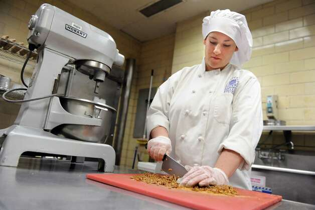 Culinary student Gracie VanderVeen, 23, works in the baking lab on Tuesday, March 31, 2015, at Schenectady County Community College in Schenectady, N.Y. (Cindy Schultz / Times Union) Photo: Cindy Schultz / 00031237A