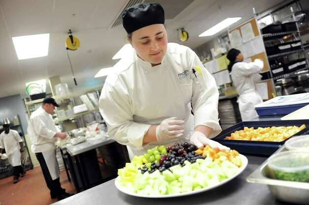 Culinary student Katie Brown, 23, works on a fruit plate she created on Tuesday, March 31, 2015, at Mazzone Hospitality Headquarters in Clifton Park, N.Y. Brown will graduate from Schenectady County Community College in May. (Cindy Schultz / Times Union) Photo: Cindy Schultz / 00031238A