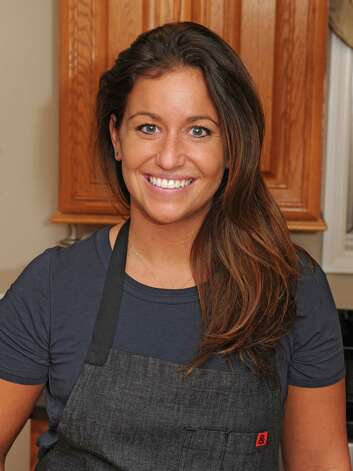 Chef Courtney Withey in the kitchen of the home she grew up in on Friday, Oct. 24, 2014 in Alplaus, N.Y.  (Lori Van Buren / Times Union) ORG XMIT: MER2014102413112596 Photo: Lori Van Buren / 00029148A
