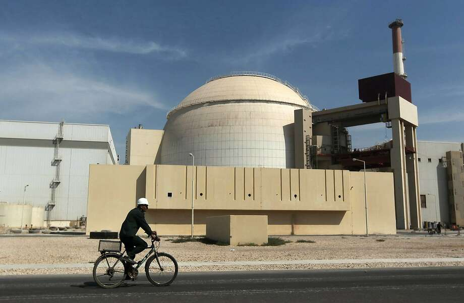 FILE - In this Oct. 26, 2010 file photo, a worker rides a bicycle in front of the reactor building of the Bushehr nuclear power plant, just outside the southern city of Bushehr.  Iran left the negotiating table in Lausanne, Switzerland, on Thursday, Aoril 2, 2015 with a commitment to implement the Additional Protocol, IAEA's most potent monitoring instrument. (AP Photo/Mehr News Agency, Majid Asgaripour, File) Photo: Majid Asgaripour, Associated Press