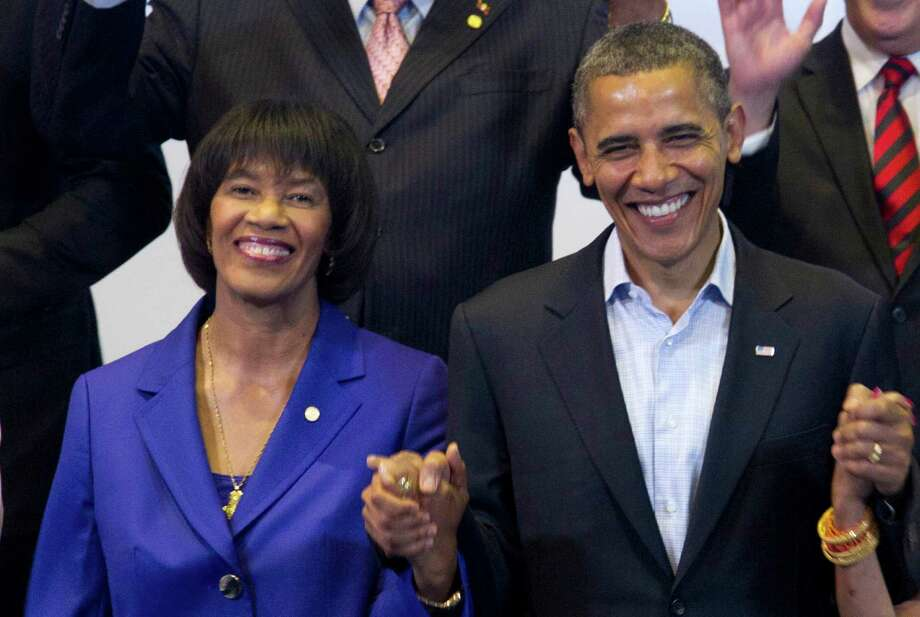 President Obama holds hands with Jamaica's Prime Minister Portia Simpson Miller during a 2012 multilateral meeting with Caribbean leaders, during the sixth Summit of the Americas in Cartagena, Colombia. Photo: Carolyn Kaster / Associated Press / AP