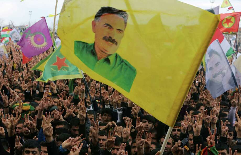 Supporters hold flags showing the image of imprisoned Kurdish rebel leader Abdullah Ocalan during the Nowruz celebrations in southeastern Turkish city of Diyarbakir. Photo: Burhan Ozbilici / Associated Press / AP