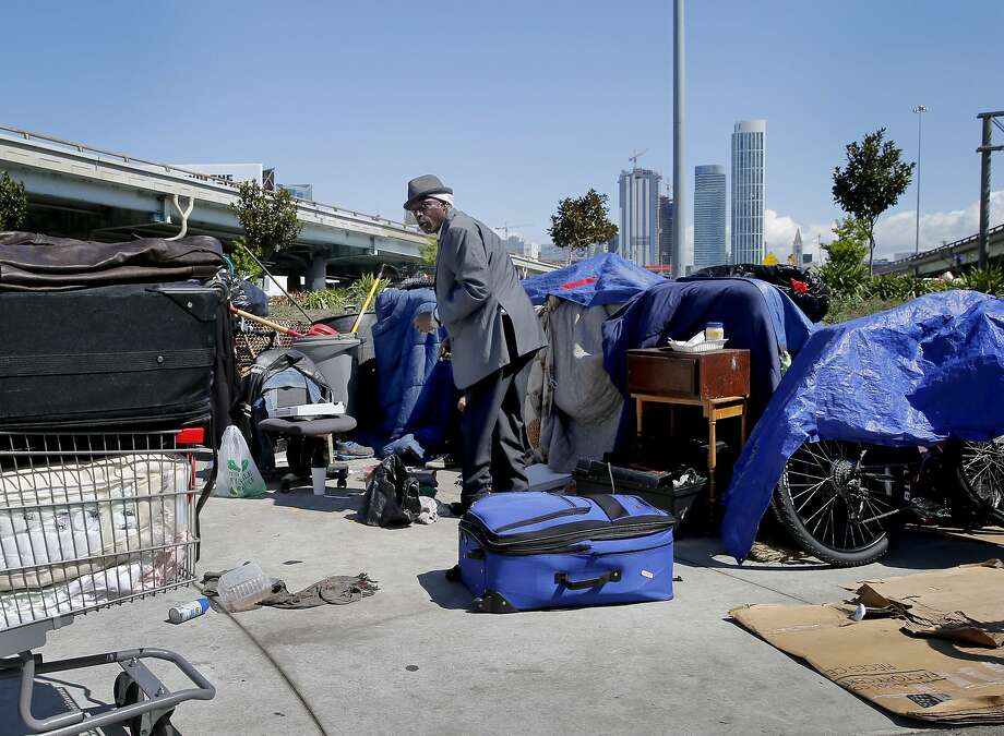 """""""Chef"""" the best dressed guy in the Fifth and Bryant Streets encampment Wednesday April 8, 2015. Southern California State Senator Carol Liu has introduced legislation to create a """"right to rest"""" law which would wipe out San Francisco's sit-lie law and legalize tent camps. Photo: Brant Ward, The Chronicle"""