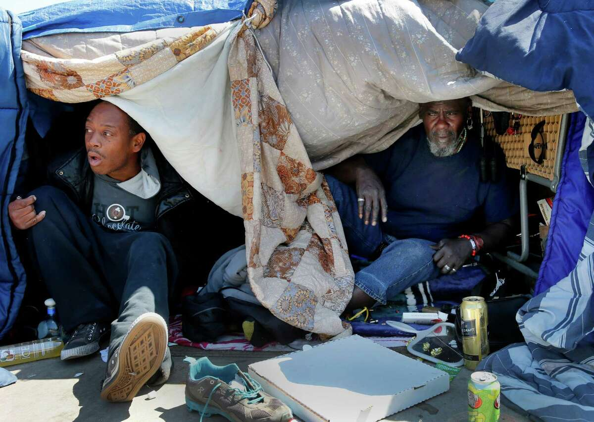 """Two men at the Fifth and Bryant Street encampment see little chance of legislation that would legalize their homeless lifestyle Wednesday April 8, 2015. Southern California State Senator Carol Liu has introduced legislation to create a """"right to rest"""" law which would wipe out San Francisco's sit-lie law and legalize tent camps."""
