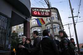 People stand outside the Lexington Club, a neighborhood lesbian bar in San Francisco, Calif., on Thursday, April 2, 2014. The bar is closing after 18 years in the Mission.