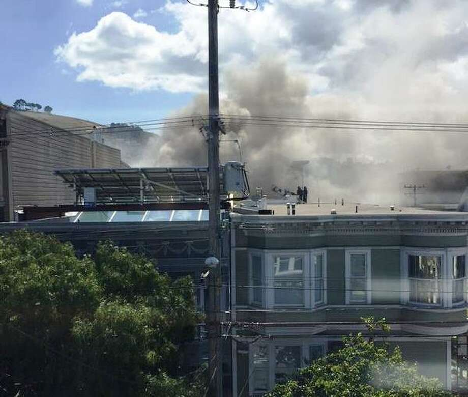 A two-alarm fire broke out Wednesday in San Francisco's Mission District. No one was injured in the blaze, which was the latest in several to break out this year in the neighborhood. Photo: Eric Prensky / ONLINE_YES