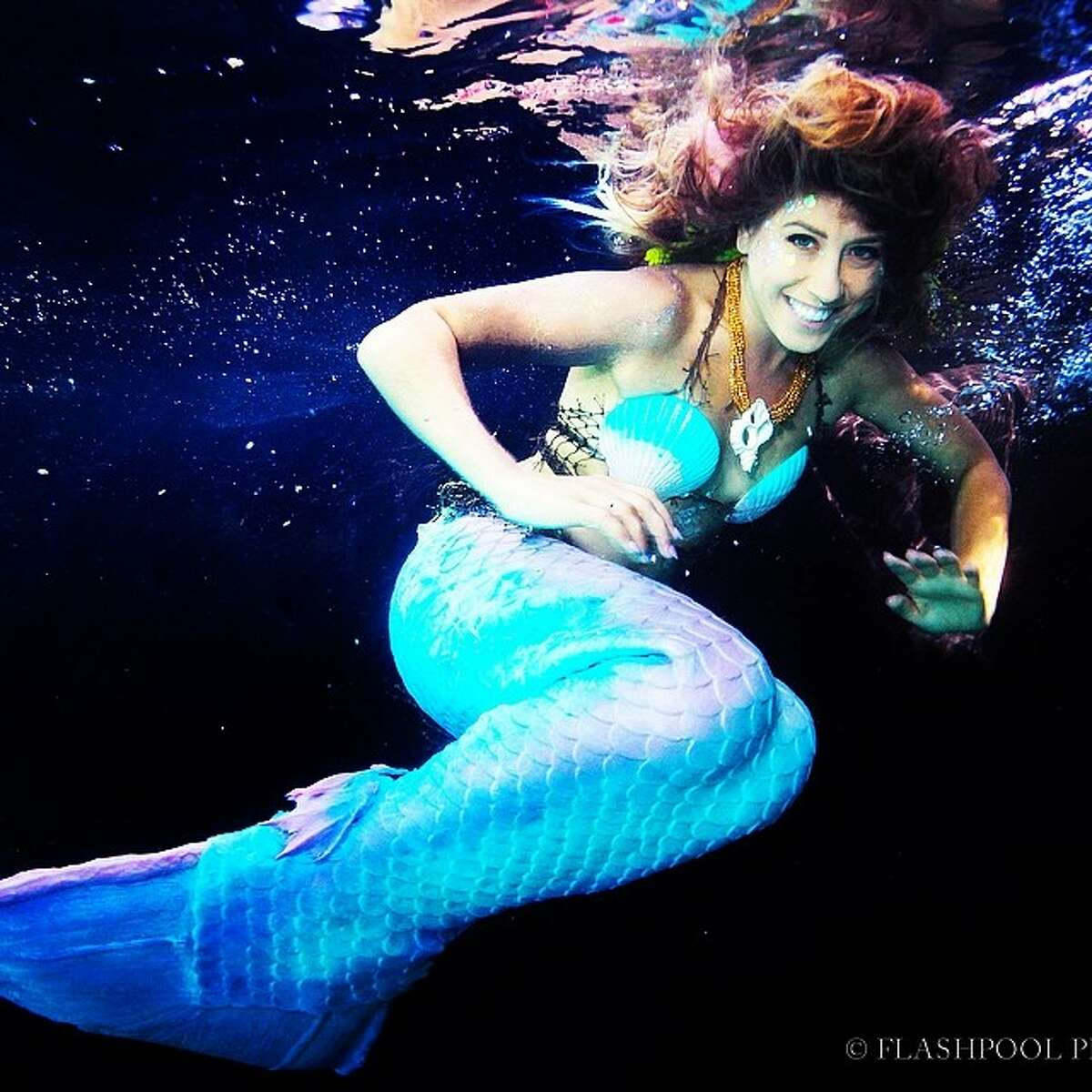 Sirenalia mermaids swim with sharks and manta rays in the Great Barrier Reef of Belize.