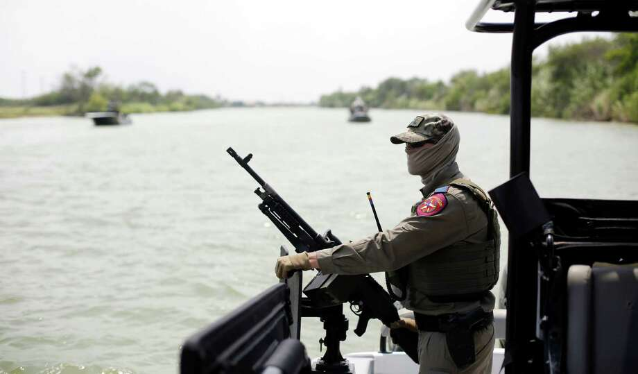 A Texas Department of Public Safety officer during a patrol on the Rio Grande along the U.S.-Mexico border near Mission, Texas, last year. DPS should provide specific numbers on its own activities if it wants full funding at the border. Photo: ERIC GAY /New York Times / POOL