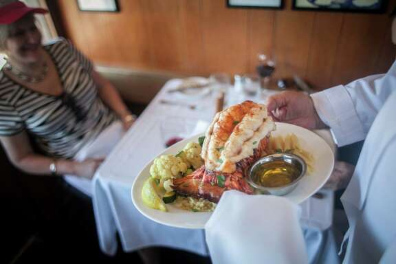 Restaurant goers prepare to eat lobster tail at Scoma's restaurant in San Francisco on September 18th 2013. Scoma's puts an emphasis on trying to serve some of the freshest fish in San francisco.