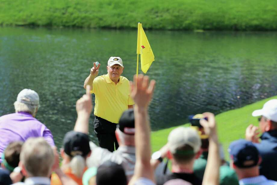 AUGUSTA, GA - APRIL 08:  Patrons watch as Jack Nicklaus celebrates his hole-in-one on the fourth hole during the Par 3 Contest prior to the start of the 2015 Masters Tournament at Augusta National Golf Club on April 8, 2015 in Augusta, Georgia.  (Photo by David Cannon/Getty Images) Photo: David Cannon / Getty Images / 2015 Getty Images