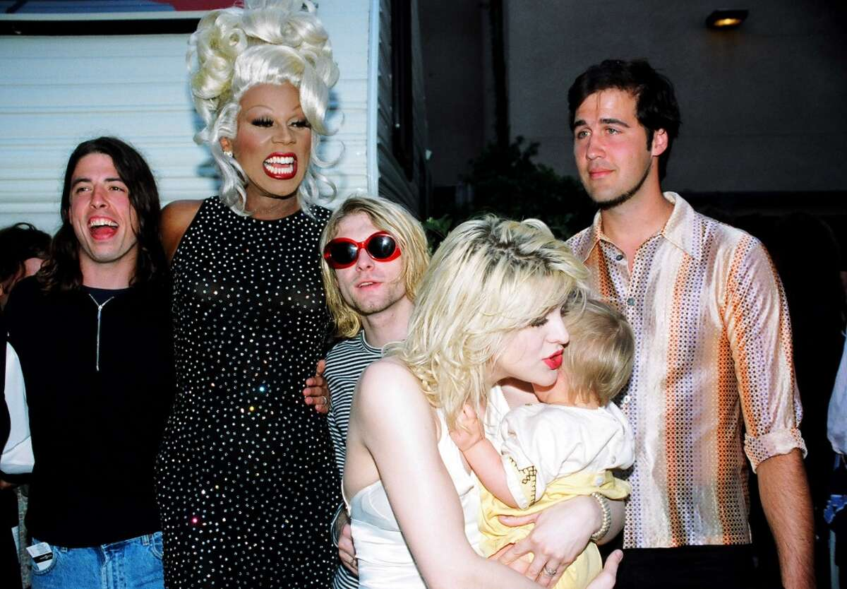 RuPaul (2nd from left) with Dave Grohl, Kurt Cobain and Krist Novoselic of Nirvana, and Courtney Love with daughter Frances Bean Cobain (Photo by Jeff Kravitz/FilmMagic, Inc)