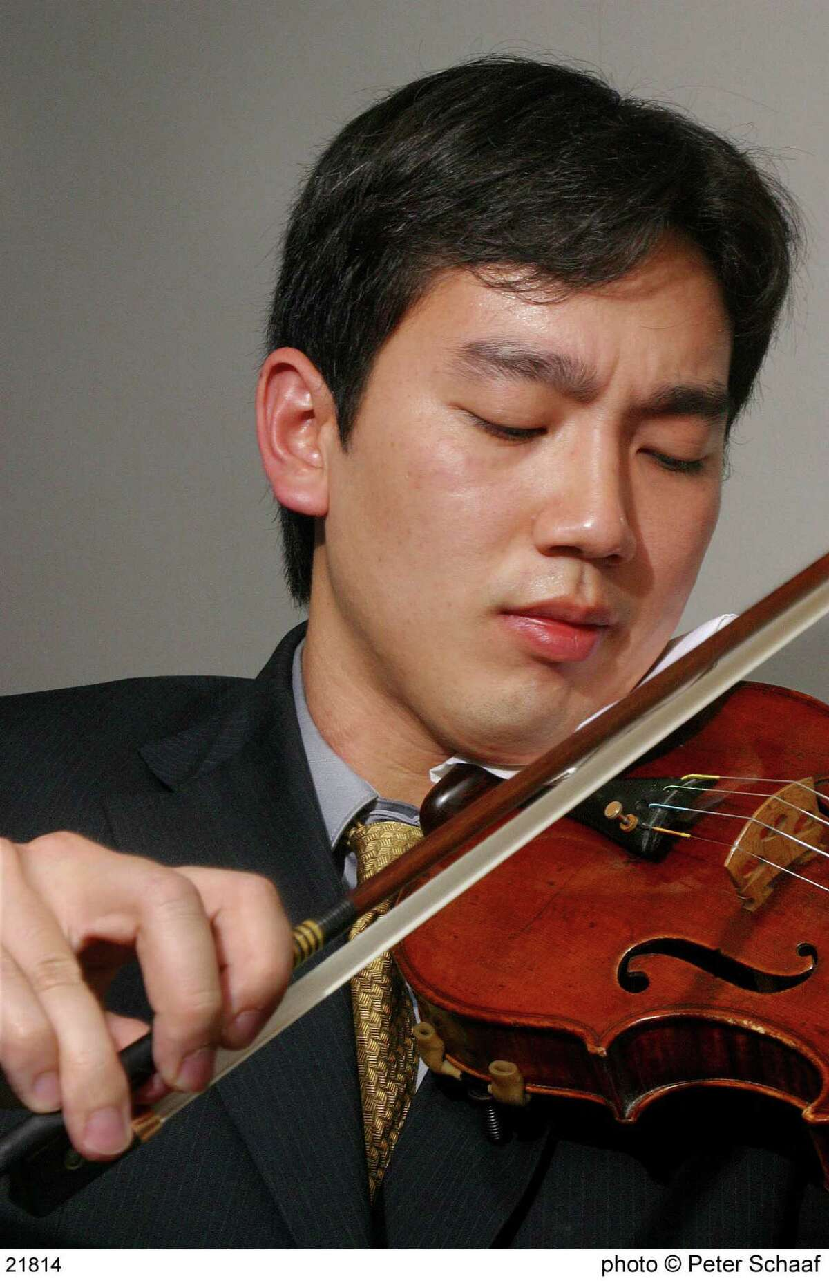 Frank Huang performing in the final round of the 2003 Walter W. Naumburg International Violin Competition at Lincoln Center, New York City. Huang was selected winner of the 2013 competition and as a result, was awarded a $10,000 cash prize as well as two Alice Tully Hall recitals, concerts throughout the country and the premiere of a new unaccompanied violin sonata by Donal Martino.