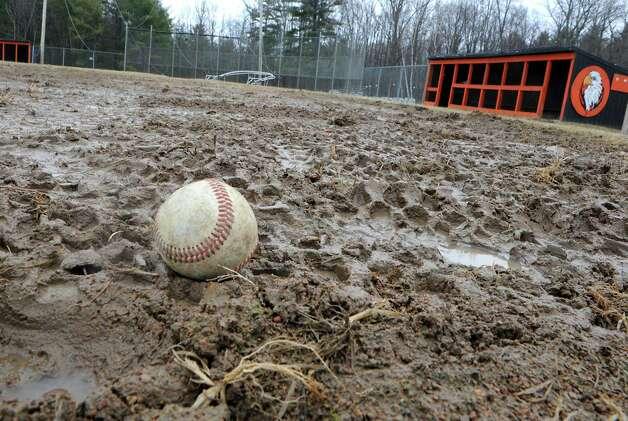 A muddy infield makes the baseball field unplayable at Bethlehem High School on Wednesday, April 8, 2015 in Delmar, N.Y.  (Lori Van Buren / Times Union) Photo: Lori Van Buren, Albany Times Union / 00031349A