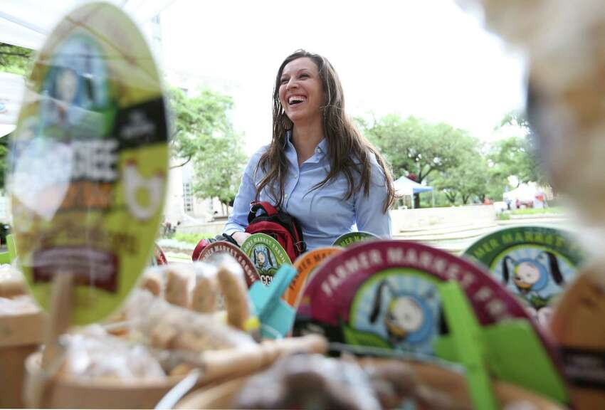 Jessica Markowski laughs while she buys doggie snacks for her dog,