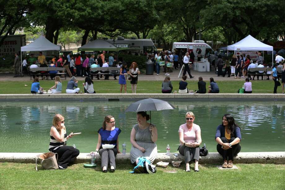 Taylor King, Mandy Terry, Leslie Kendall, Julie Sanders and Mahreen Arain enjoy the weather at the weekly farmer's market in Hermann Square Wednesday, April 8, 2015, in Houston. Photo: Jon Shapley, Houston Chronicle / © 2015 Houston Chronicle
