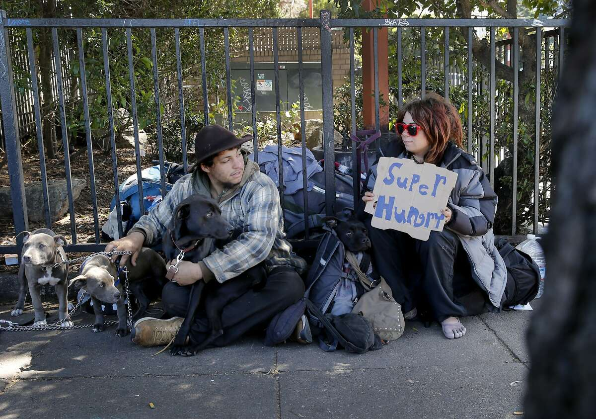 """A young woman named """"Little"""" (right) and her friend """"Light"""" try to raise some money on Haight Street near the McDonalds Wednesday April 8, 2015. Southern California State Senator Carol Liu has introduced legislation to create a """"right to rest"""" law which would wipe out San Francisco's sit-lie law and legalize tent camps."""