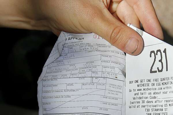 "A young man shows off his ticket he received under the sit-lie law on Haight Street next to a receipt from the restaurant he visited. Southern California State Senator Carol Liu has introduced legislation to create a ""right to rest"" law which would wipe out San Francisco's sit-lie law and legalize tent camps."