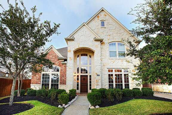 Pearland: Four-bedroom home has a sun room, media room, exercise room and a pool with a hot tub and waterfall. 5,874 square feet