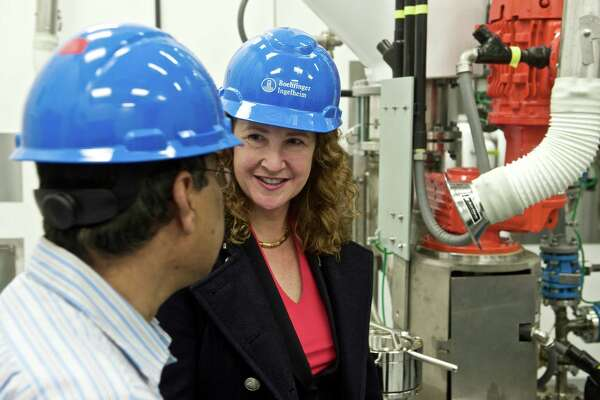 Azad Hossain, Director of Chemical Development, left, talks with U.S. Representative Elizabeth Esty, 5th District of Connecticut, during a tour of the Boehringer Ingelheim USA Corporation new pilot research building at their Danbury, Conn, campus on Wednesday, April 8, 2015.