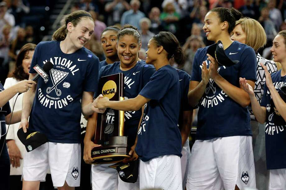 UConn's Breanna Stewart, left, and Moriah Jefferson celebrate on stage after defeating Notre Dame to win the national championship Tuesday night in Tampa, Fla. Photo: Mike Carlson, Mike Carlson/Getty Images / 2015 Getty Images