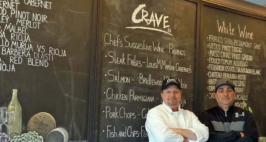 Crave Bar and Grill's executive chef, Brantley Mozingo, stands in the restaurant's main dining room with one of the owners, Alfonso Cammarota. The restaurant and bar opened this week at 52 Sanford Street. Photo: Genevieve Reilly / Fairfield Citizen