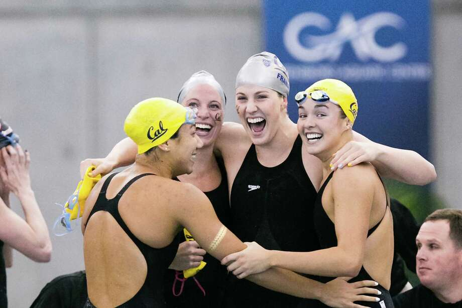 Farida Osman (left), Kaylin Bing, Missy Franklin and Rachel Bootsma exult after winning the 200 free relay at the NCAA Championships in Indianapolis. They helped coach Teri McKeever (below, in white) win a fourth national title in seven years. Photo: Cal Athletics / Cal Athletics / ©Tim Binning/TheSwimPictures.com