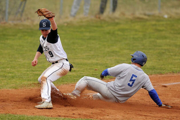Staples third baseman Zach Azadian forces out Newtown's Jack Procaccini at third base during their baseball game at Staples High School in Westport, Conn., on Wednesday, April 8, 2015. Staples won, 5-4. Photo: Jason Rearick / Stamford Advocate