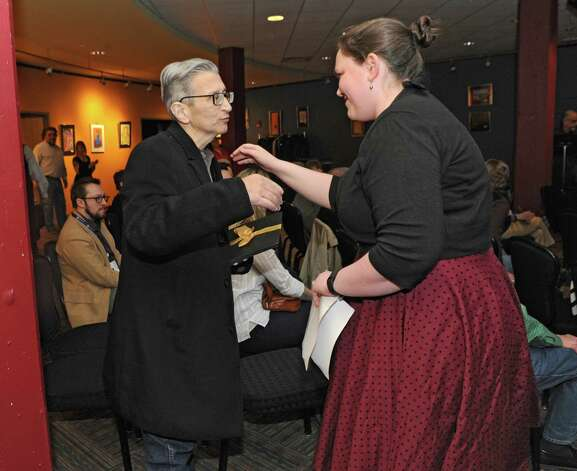 Schenectady high teacher Bill Ziskin gets a hug from his former student Jessica Silverstein after she spoke at Proctors on Tuesday, April 7, 2015 in Schenectady, N.Y. His friends and students surprised him with the news that they've nominated him for a new Tony award honoring theater educators. (Lori Van Buren / Times Union) Photo: Lori Van Buren / 00031340A