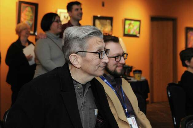 Schenectady high teacher Bill Ziskin, left, smiles as he watches a film showing images of him and his students at Proctors on Tuesday, April 7, 2015 in Schenectady, N.Y. His friends and students surprised him with the news that they've nominated him for a new Tony award honoring theater educators. (Lori Van Buren / Times Union) Photo: Lori Van Buren / 00031340A