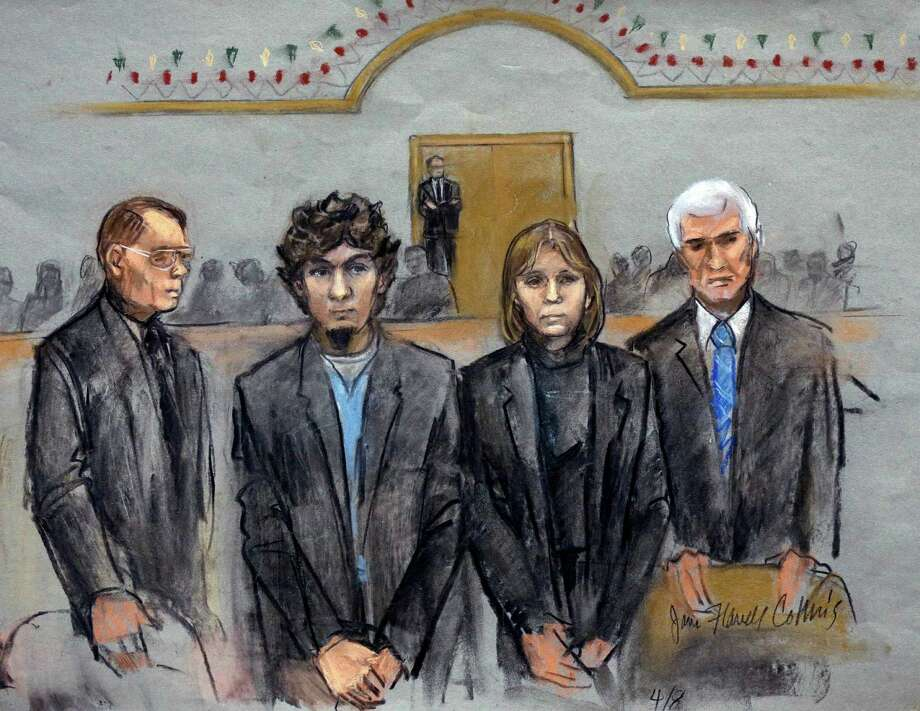 In this courtroom sketch, Dzhokhar Tsarnaev, second from left, stands with little expression as the verdict is read.  Photo: Jane Flavell Collins, FRE / Jane Flavell Collins