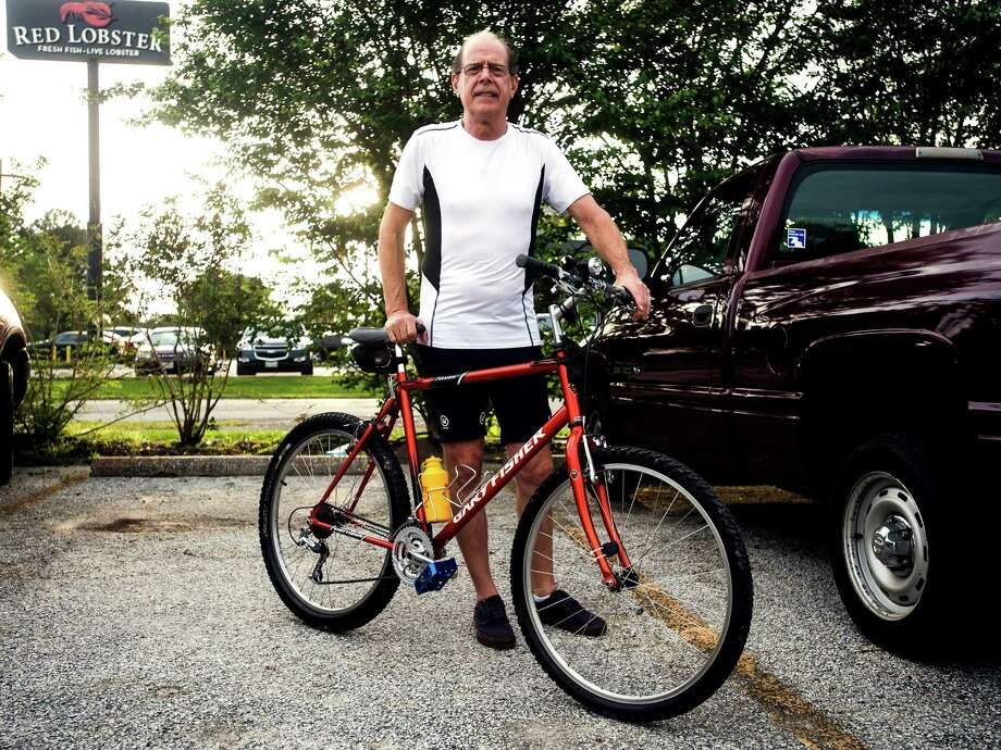 Tom Luxton poses for a photo with his 1995 Gary Fisher mountain bike Wednesday. Cyclists gathered at Bicycle Sports for a conversational bike ride Wednesday evening. Photo taken Wednesday 4/8/15 Jake Daniels/The Enterprise Photo: Jake Daniels / ©2015 The Beaumont Enterprise/Jake Daniels