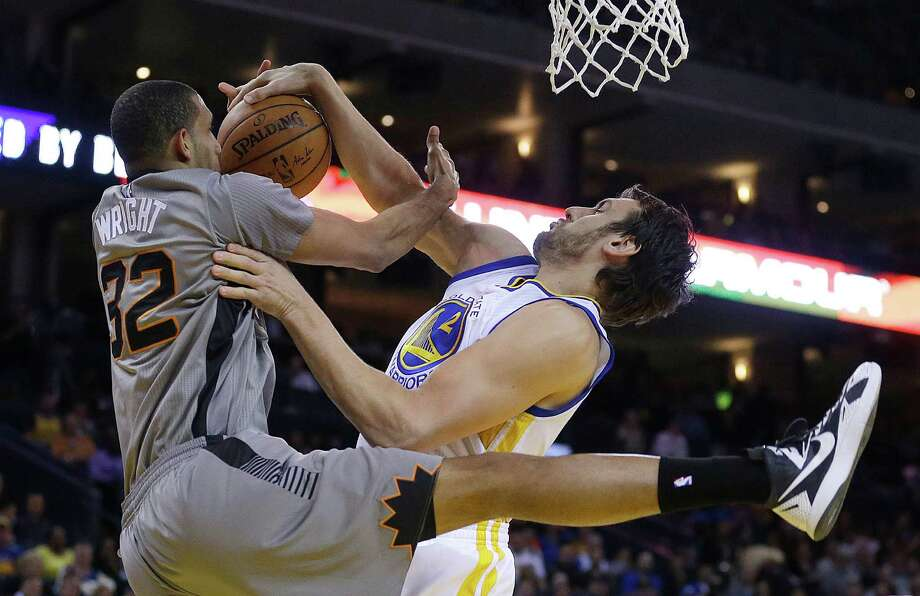 Golden State's Andrew Bogut snuffs a shot attempt by Phoenix's Brandan Wright earlier this month. Bogut had a big night Tuesday with nine blocks. Photo: Ben Margot / Associated Press / AP