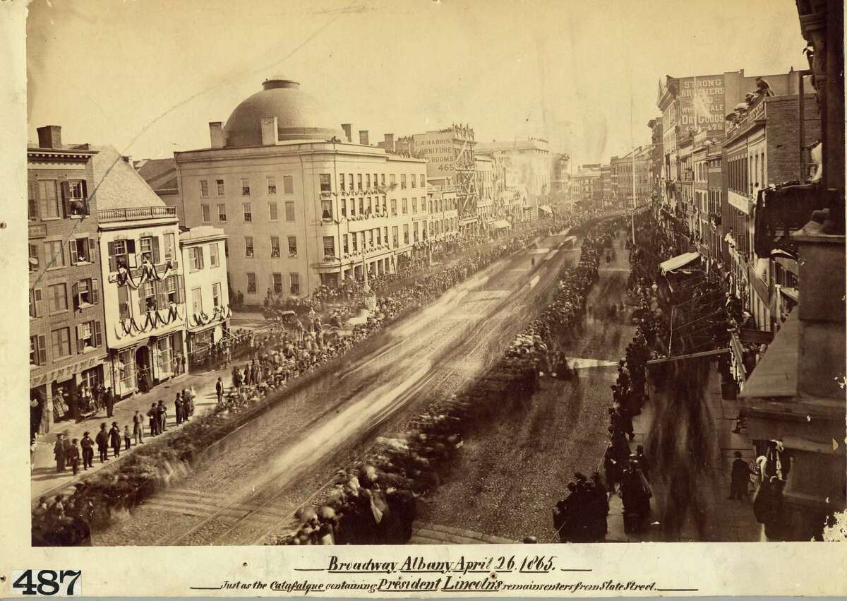 Mourners lined Broadway, stood on rooftops and crowded at apartment windows to view Lincoln's funeral procession through Albany on April 26, 1865. (Courtesy NYS Division of Military & Naval Affairs