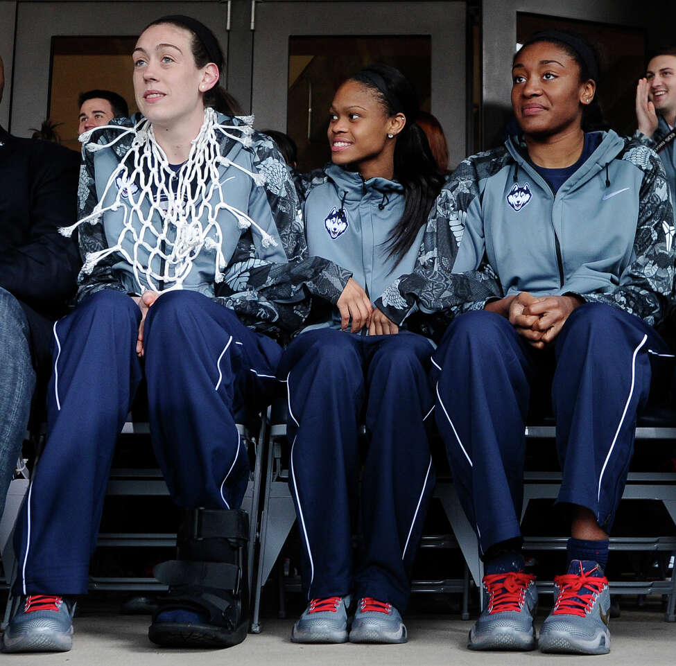 Connecticut's Breanna Stewart, left, Moriah Jefferson, center, and Morgan Tuck, right, sit during a rally on campus to celebrate their team's 10th national title and third in a row, Wednesday, April 8, 2015, in Storrs, Conn. (AP Photo/Jessica Hill) ORG XMIT: CTJH103