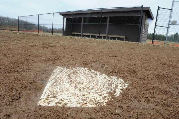 A muddy home plate is seen on the softball field at Bethlehem High School on Wednesday, April 8, 2015 in Delmar, N.Y.  (Lori Van Buren / Times Union) Photo: Lori Van Buren / 00031349A