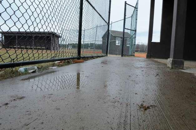 A puddle of rain is seen in the dugout of the softball field at Bethlehem High School on Wednesday, April 8, 2015 in Delmar, N.Y.  (Lori Van Buren / Times Union) Photo: Lori Van Buren / 00031349A