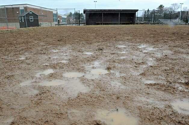 A muddy infield makes the softball field unplayable at Bethlehem High School on Wednesday, April 8, 2015 in Delmar, N.Y.  (Lori Van Buren / Times Union) Photo: Lori Van Buren / 00031349A