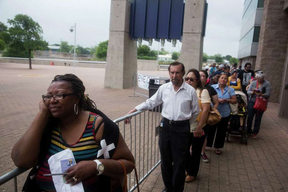 """Regina Hunter waits in line for the free eye care clinic at the Alamodome in San Antonio, TX on Wednesday, April 8, 2015.  She stood in line with her sister for nearly three hours.  """"It is a long line,"""" she said.  """"People camped out here yesterday, since it is first come, first served.  I couldn't do that though, so here I am in line.""""  More than 1,500 healthcare professionals and volunteers came from all over the country to operate the no-cost medical, dental and eye care clinic.  Over $10 million in health care services are available within 72 hours at the Alamodome.  No insurance or identification are required and all services are on a first come, first served basis.  Your Best Pathway to Health, the organizer of the event, estimates that services will be offered to approximately 6,000 San Antonio residents by the end of the event.  The organization is in partnership with the Seventh-Day Adventist Church and nearly 100 donor organizations.  Of the event, Executive Director Lela Lewis said, """"When Jesus was on Earth, he provided healthcare and food to those in need, so we are honored to do the same."""" Photo: Carolyn Van Houten, Staff / San Antonio Express-News / 2015 San Antonio Express-News"""