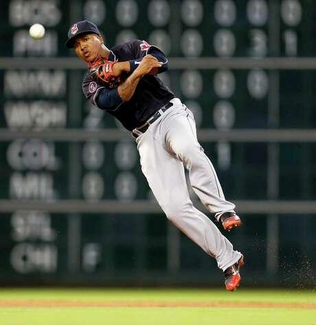 Indians shortstop Jose Ramirez snaps a throw to first to retire Jose Altuve. Photo: Karen Warren, Staff / © 2015 Houston Chronicle
