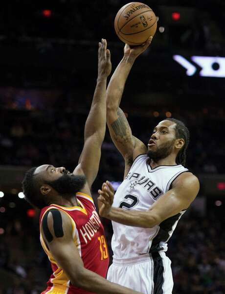 The Spurs have thrived since Kawhi Leonard, shoot-ing over James Harden on Wednesday, got healthy. Photo: Darren Abate, FRE / FR115 AP