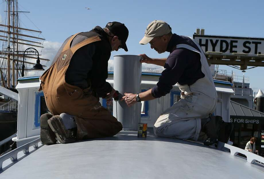 Volunteers Rod Baker (left) and George Ushanoff work on completing the final touches on the rebuilt Eva B at the Maritime National Historical Park in San Francisco, Calif., on Wednesday, April 8, 2015. Photo: Amy Osborne, The Chronicle