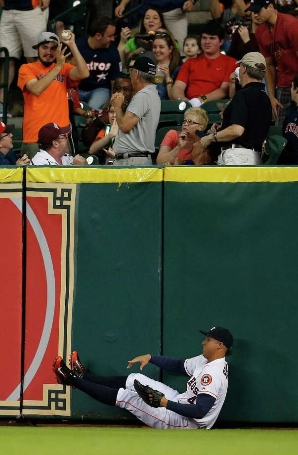 A valiant effort by Astros right fielder George Springer goes for naught on his bid to prevent a home run hit by Indians first baseman Carlos Santana in the fourth inning. Photo: Karen Warren, Staff / © 2015 Houston Chronicle