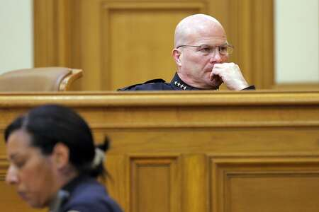 San Francisco Police Chief Greg Suhr looks at a screen during the San Francisco Police Commission meeting on  Wednesday, April 8, 2015, in San Francisco, Calif. The fate of several San Francisco Police officers involved in racist and homophobic text messaging was under consideration by the commission in a closed session later in the meeting.